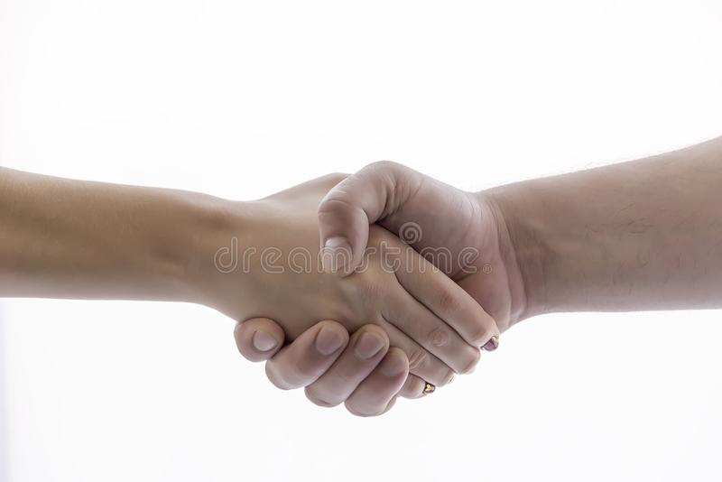Hand shakes hand in greeting. For background and business royalty free stock photos