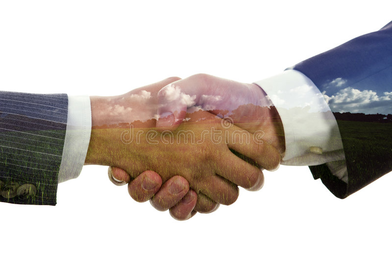 Hand shaking on a landscape. Background - environment concept stock photography