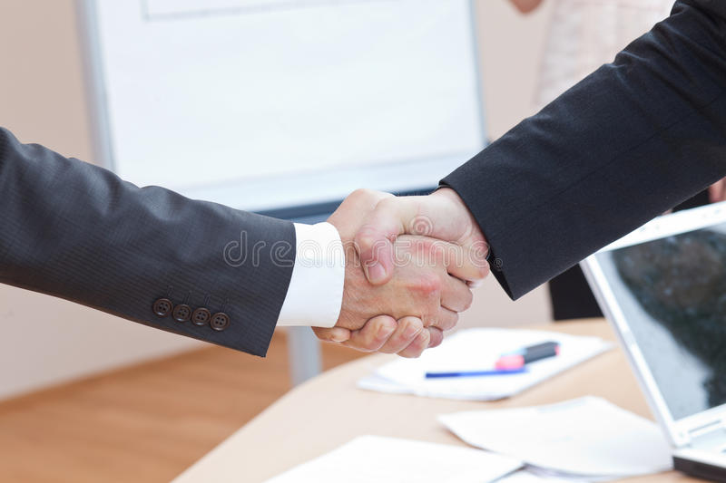 Hand shaking at office stock image