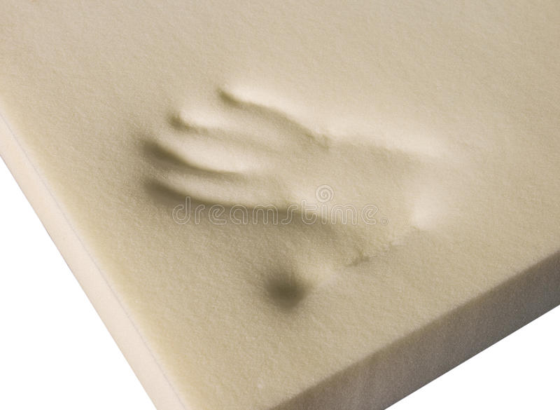 Hand shape in foam. A hand shape in a furniture foam royalty free stock images