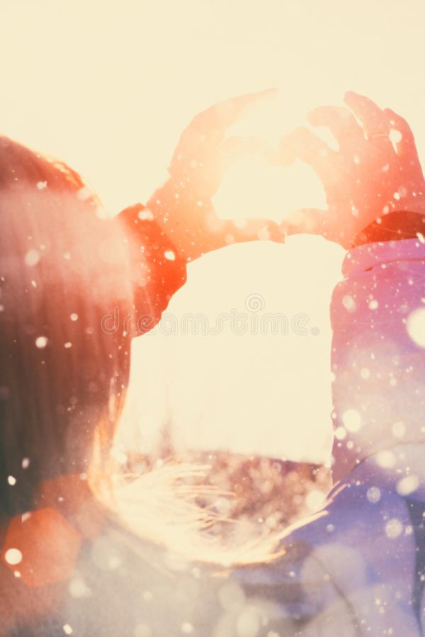 Hand shaped heart against sky background royalty free stock photo