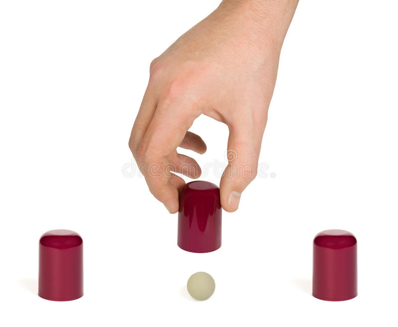 Hand and shell game stock image