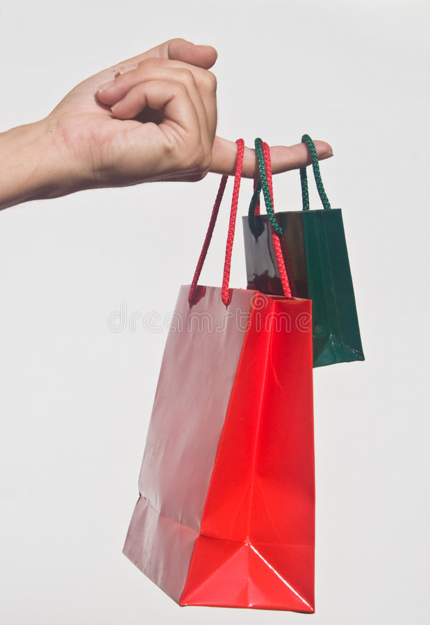 Download Hand with shopping bags stock image. Image of gifts, holding - 8216899