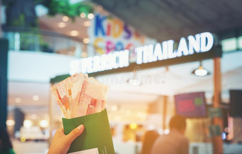 Hand show China - Hongkong money currency exchange background blur booth of Superrich Thailand, the foreign currency exchange stock photos