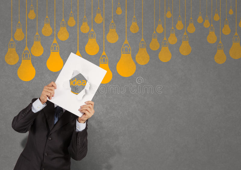 Hand showing light bulb crumpled paper stock image