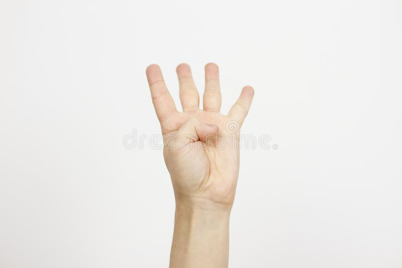 Hand showing number four on white background, closeup. Sign language stock photos