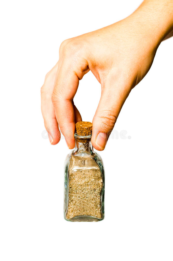 Hand showing a sand glass bottle royalty free stock photography