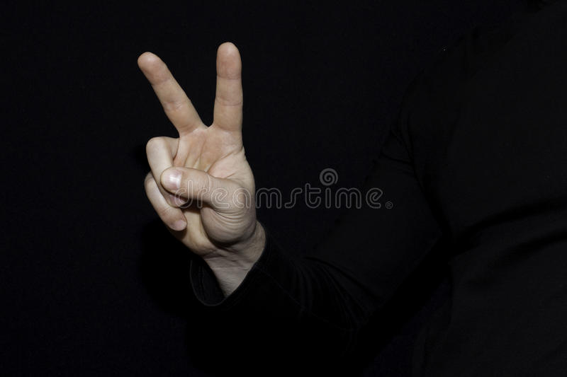 Hand showing the sign of victory and peace. Man hand gesturing p royalty free stock image