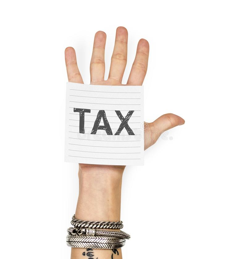 Hand showing a sticky note with Tax royalty free stock photography