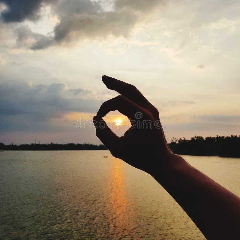 Hand sign language background sunset sky stock image