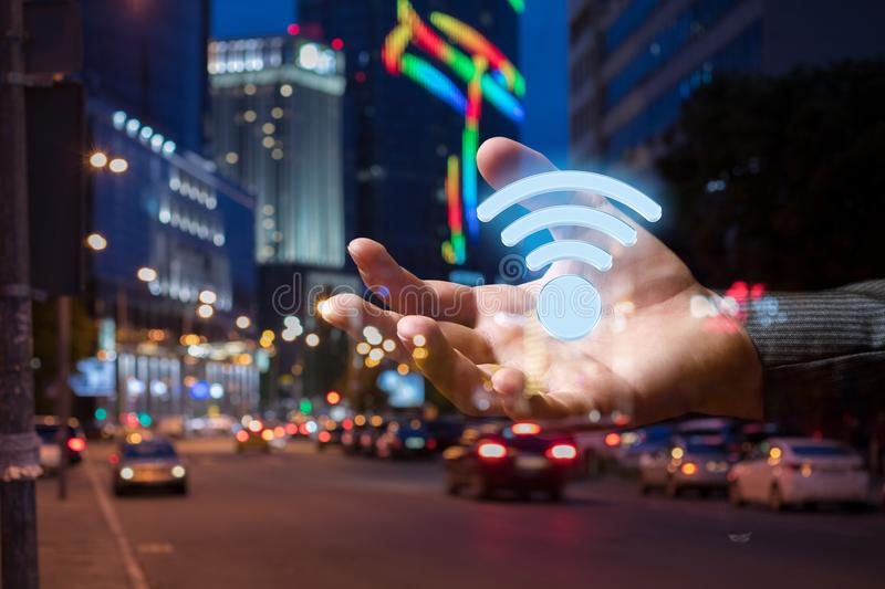 Hand with the sign of the Wifi zone . royalty free stock images