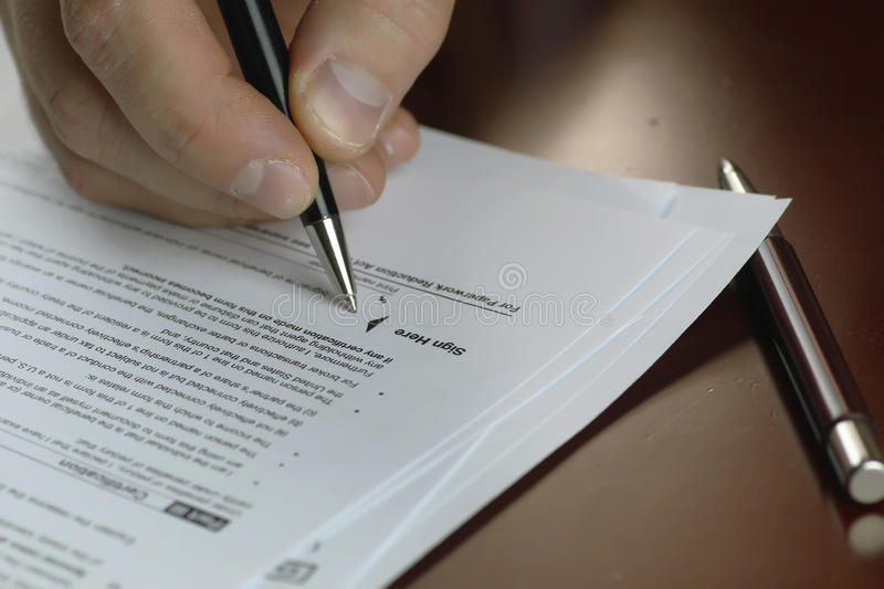 Hand signed tax form stock image