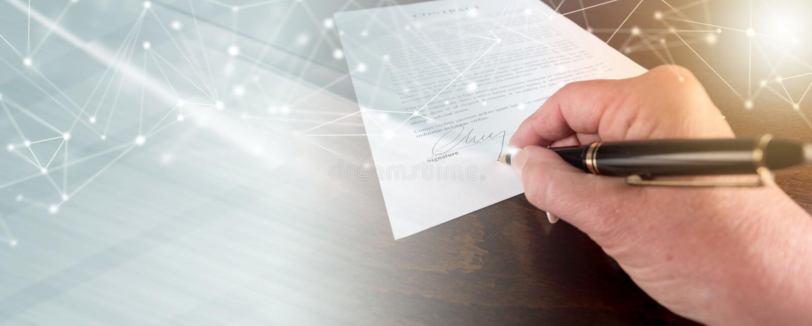 Hand signing a contract, light effect stock photo