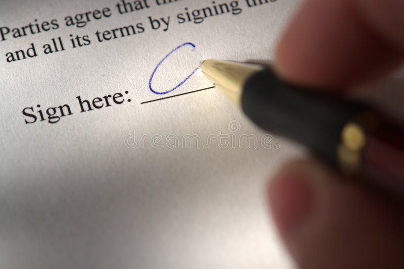 Hand Signing a Legal Document with a Pen stock image