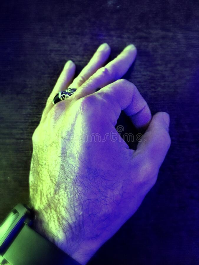 Hand with silver ring and smart watch, means sign ok symbol. Wallpaper stock photography