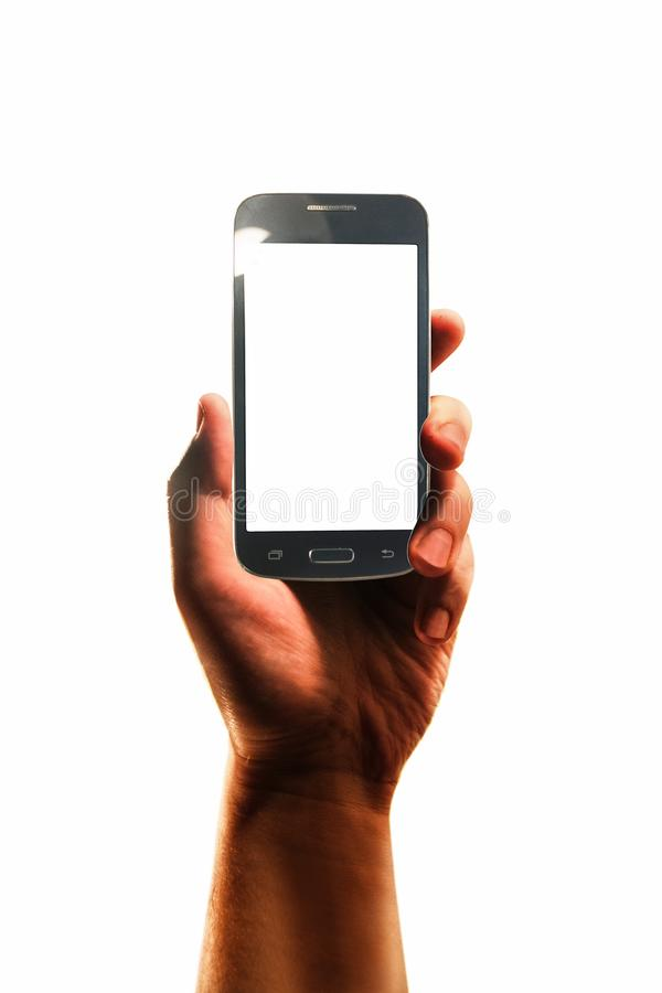 Hand with smartphone isolated in white background stock photo