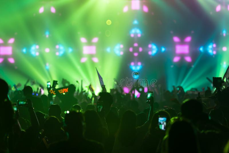 Hand with a smartphone records live music festival Taking photo of concert stage live concert music festival happy youth luxury. Party landscape exterior stock photography