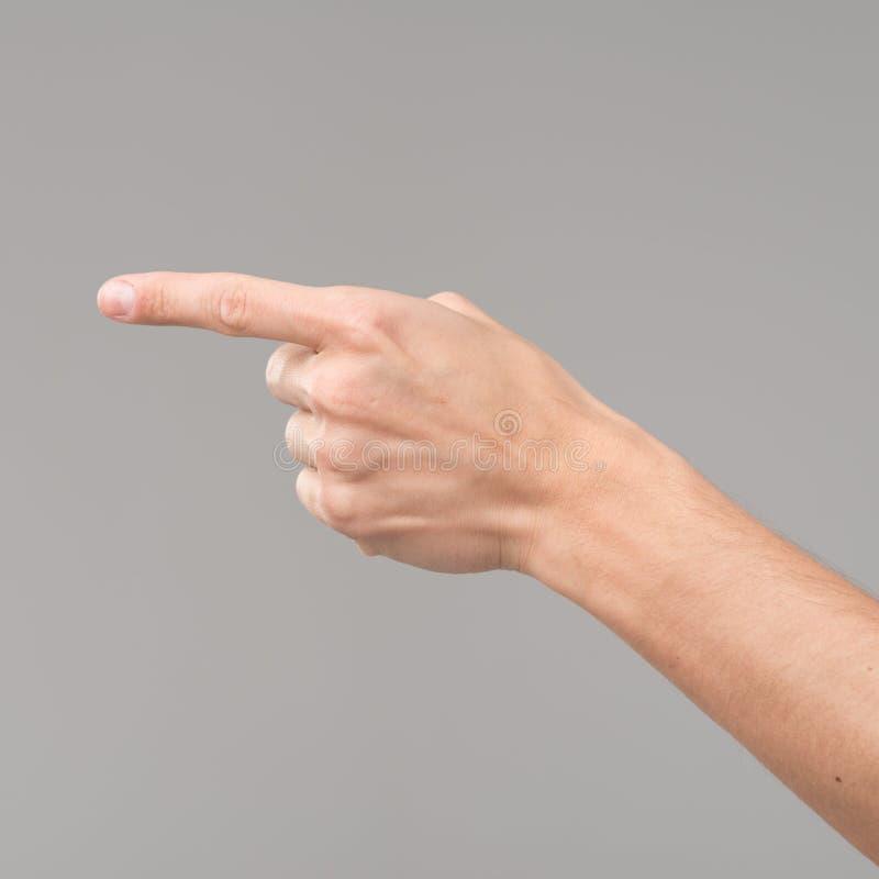 Hand som indikerar en riktning fotografering för bildbyråer