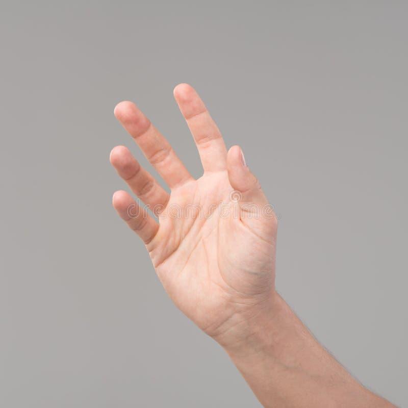 hand som ner upp arkivfoton