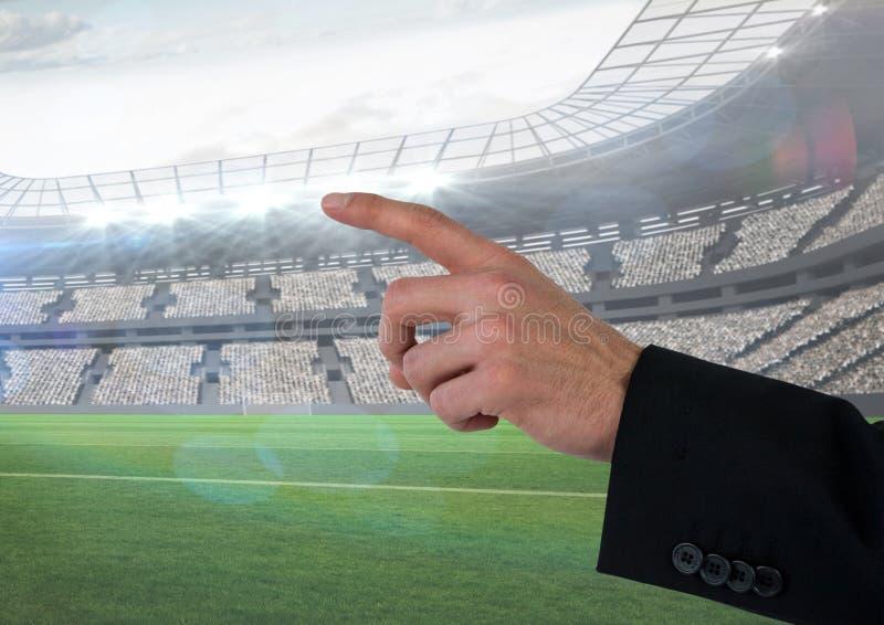 Hand som pekar i stadion av chefen arkivfoton