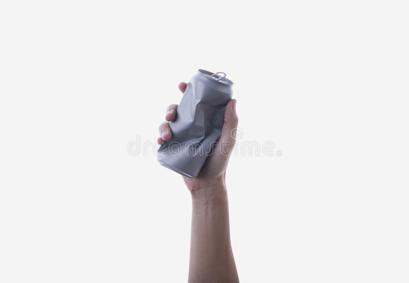 Hand som rymmer den aluminium canen återanvänd det isolerade begreppet royaltyfri fotografi