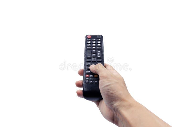 Hand som rymmer den avlägsna kontrollanten som isoleras på vit bakgrund med urklippbanan royaltyfri fotografi