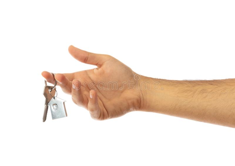 Hand som rymmer en hustangent isolerad på vit bakgrund, snabb bana arkivbild