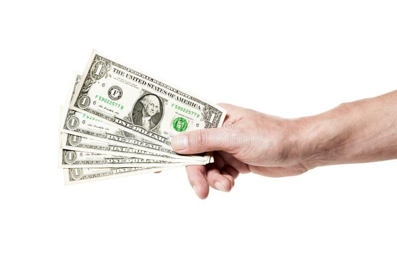 Hand som rymmer fem dollar isolerade arkivfoto