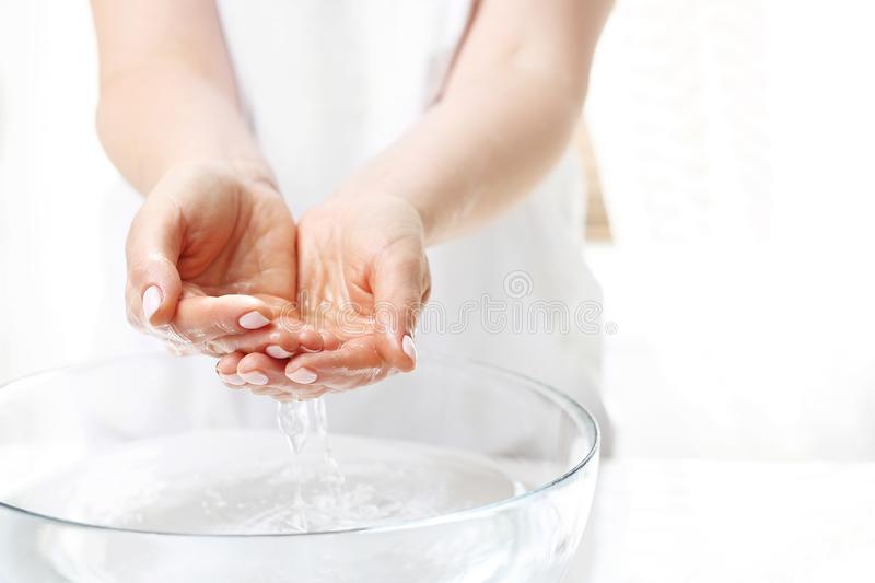 Hand spa. Hand skin care. The woman washes her hands stock photos