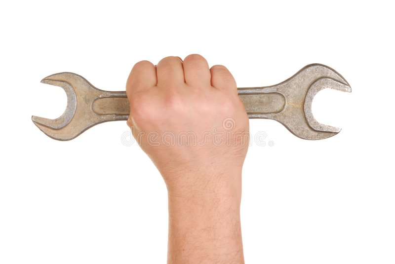 Hand with Spanner. Hand holding big spanner isolated on white royalty free stock photography