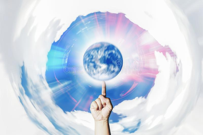 Hand Spinning earth meaning of manipulation. royalty free stock photos