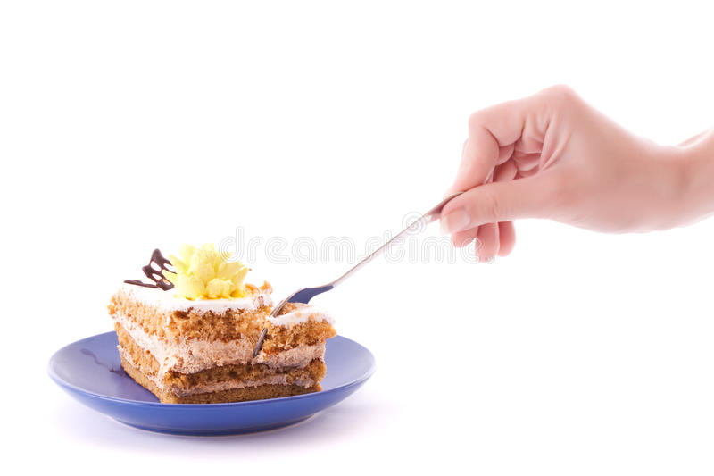 Download Hand With Spoon Snap Off A Peace Of Cake Stock Image - Image: 9850193