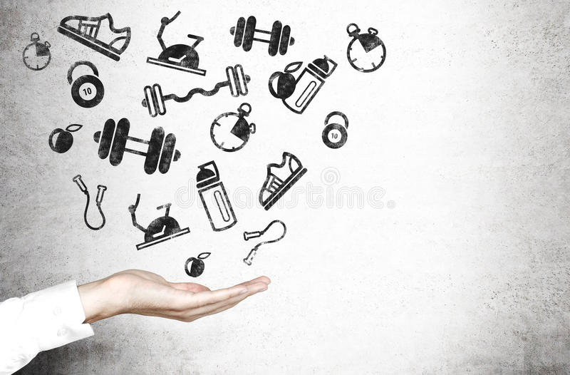 Hand and sporting goods. White hand and sporting goods sketch on light concrete wall royalty free stock images