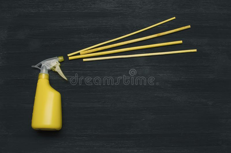 Hand sprayer bottle and aroma sticks incense. stock image