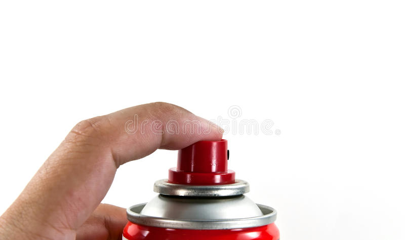 Hand Spraying with a can. Human hand holding spray can royalty free stock photography