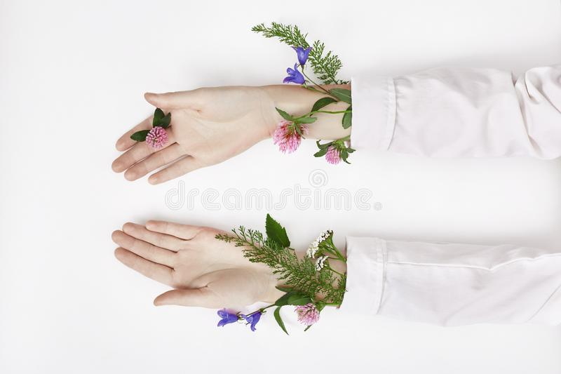 Hand and spring color flower are on table skincare. Nature Cosmetics for hand skin care, a means to reduce wrinkles on hands,. Moisturizing. Natural cosmetics stock photo