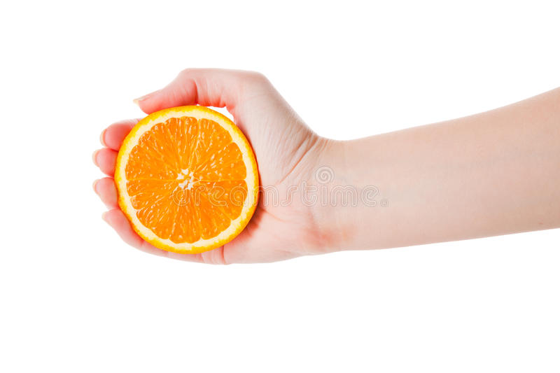 Download Hand Squeezing An Half Of Orange Stock Photography - Image: 12178022