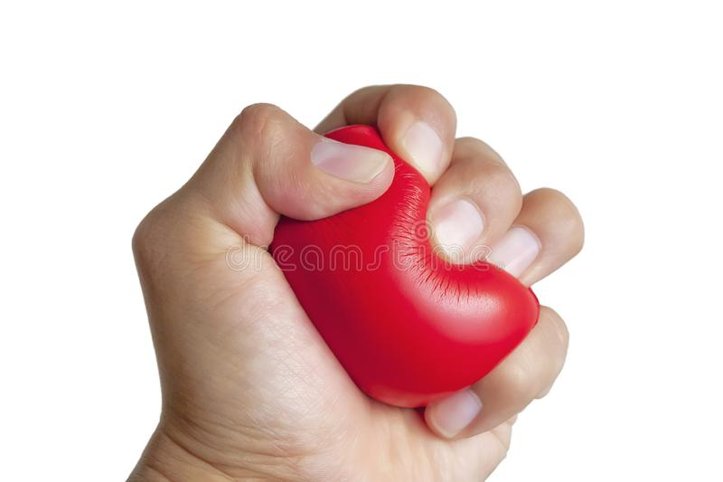 Hand squeezing a red stress ball royalty free stock photo
