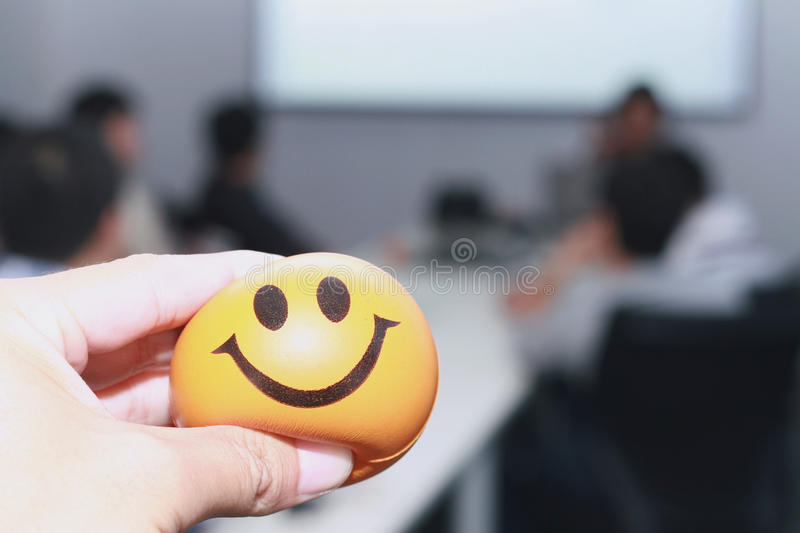 Hand squeezing the stress ball stock photography