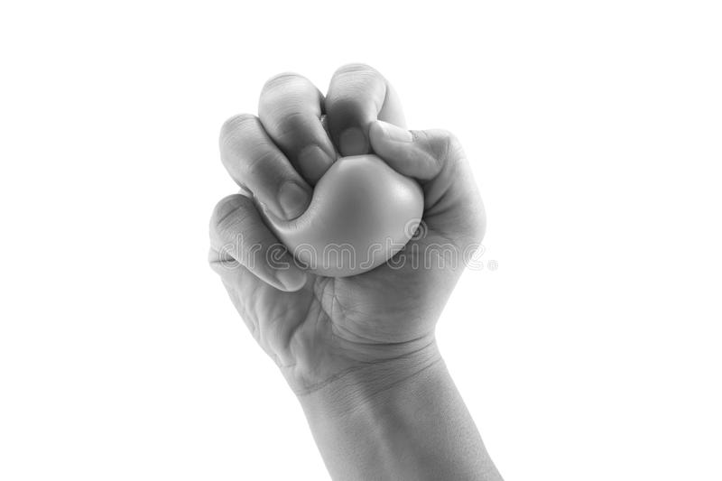 Hand squeezing a stress ball royalty free stock images