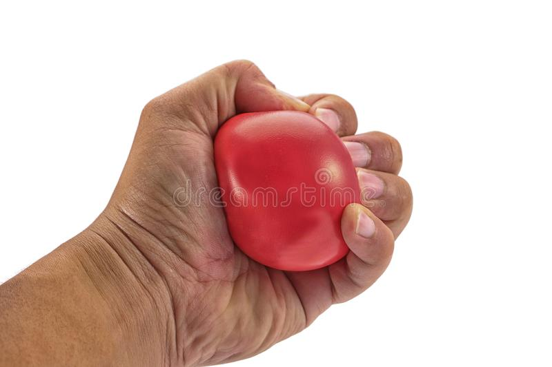 Hand squeezing a stress ball stock images