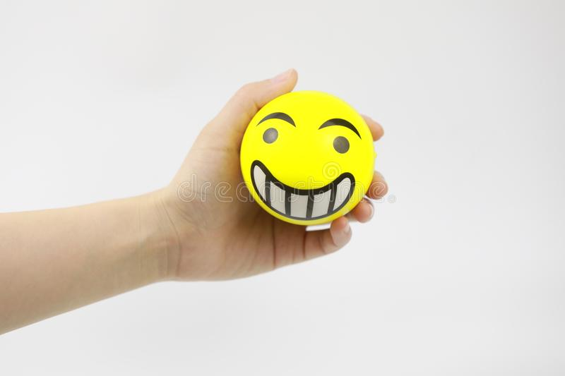 Hand squeezing the stress ball stock image