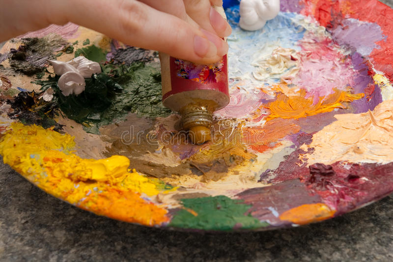 Download Hand Squeezing Yellow Oilpaint On Palette Stock Photo - Image: 12681556