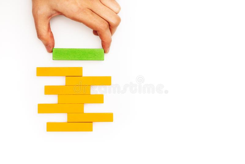 Hand stacking wooden block with copy space royalty free stock photo