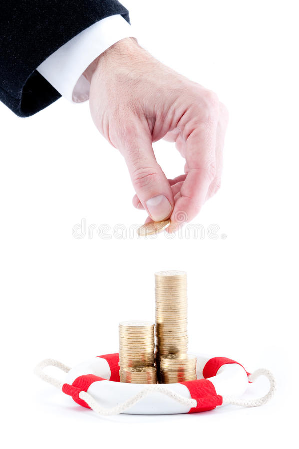 Hand with stacks of coins. Businessman hand with stacks of coins and lifebelt isolated on white background stock images