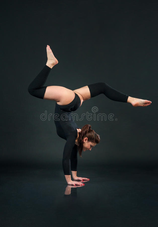 Hand Stand. Girl Acrobat Performer doing Hands Standing Upside D royalty free stock image