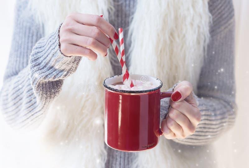 Hand stirring hot chocolate stock photography
