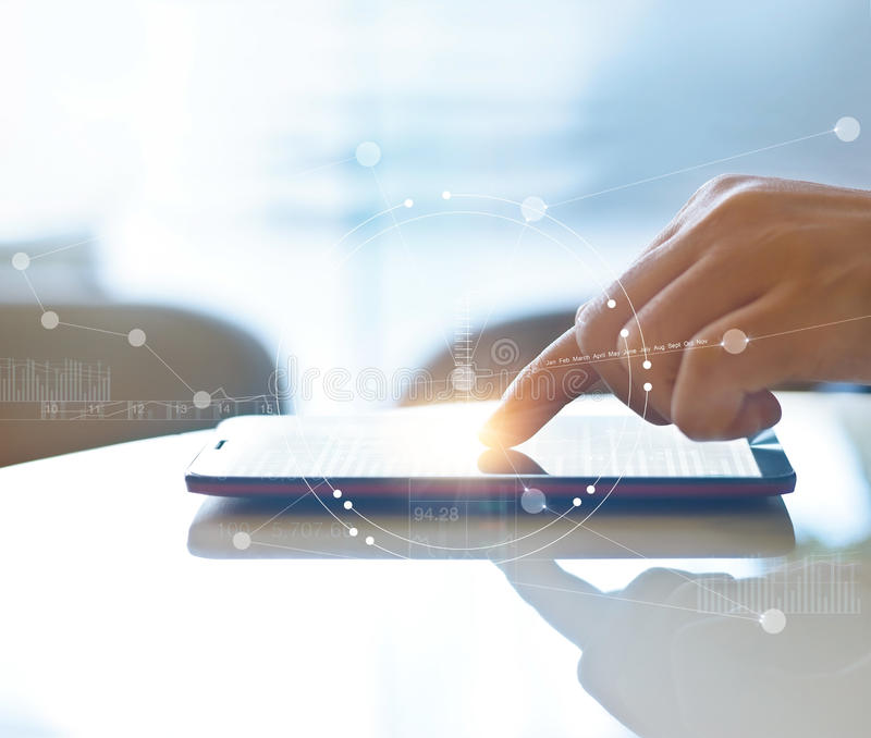 Hand of stock investment using smartphone for checking worldwide stock exchanges interface on screen with graphic icons. Soft focus stock illustration
