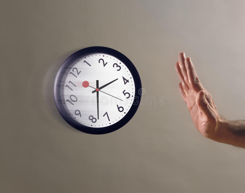 Download Hand stopping flying clock stock image. Image of finger - 27560409