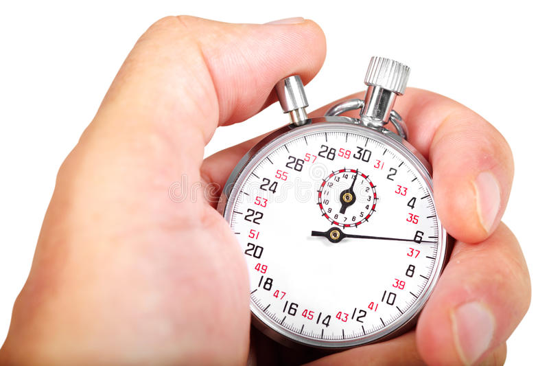 Hand and stopwatch royalty free stock image